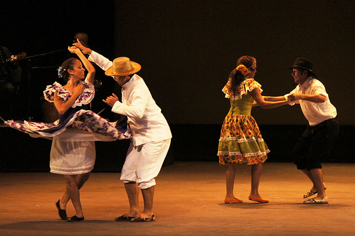 Two couples dancing joropo in the stage
