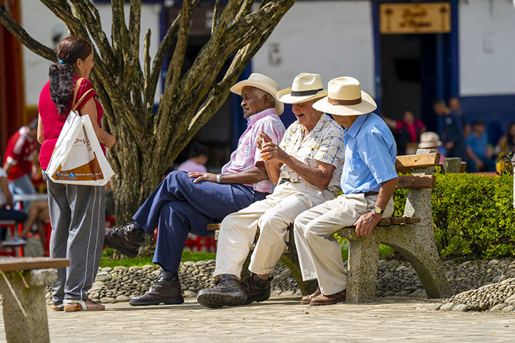 Men talking in the central park of Jardín Antioquia